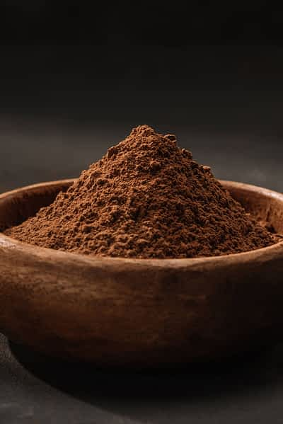 A bowl full of cacao powder.