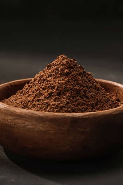 A bowl of cacao powder.