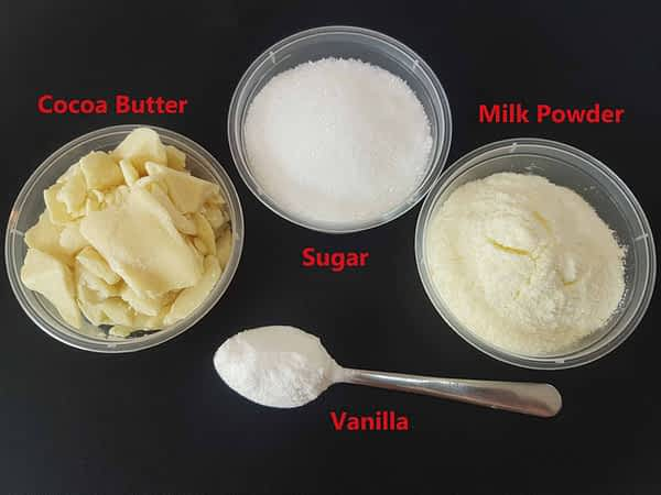 Ingredients for making white chocolate - Cocoa Butter, Sugar, Milk Powder and Vanilla.